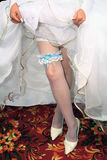 Wedding garter on leg Stock Image