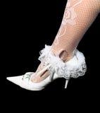 Wedding garter on leg Stock Photo