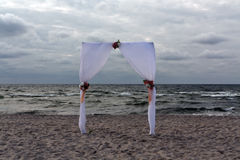 Wedding gate on Baltic seashore. Abstract background stock images