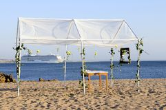 Wedding Gazebo on the Beach and Cruise Ship on the Stock Photo