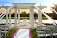 Wedding gazebo. On a lake shore in the park at the sunset Royalty Free Stock Photo