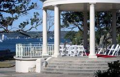 Wedding gazebo near lake. A gazebo near a lake waterfront or shore used as a venue for weddings Stock Image
