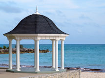 Wedding gazebo on a tropical beach. White gazebo for weddings overlooking tropical beach Royalty Free Stock Images