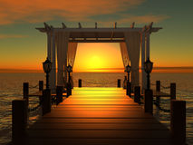 Wedding gazebo on the wooden pier at sunset Stock Photography