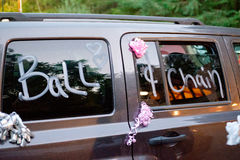 Wedding Getaway Vehicle. Decorated as a prank for this wedding couple leaving their reception Stock Image