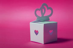 Wedding gift. Elegance romantic hearts-symbol on a pink background Stock Photography