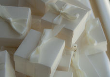 Wedding gift boxes and ribbon. White wedding gift boxes tied with white ribbon Stock Photo