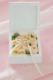 Wedding gift casket decorated with bow and buds Stock Photography