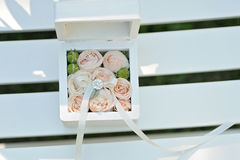 Wedding gift casket decorated with bow and buds Royalty Free Stock Images