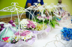 Wedding Gift Decorations. A row of decorated wedding gifts from groom to bride Stock Photos