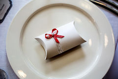 Wedding gift. At dish with red ribon Stock Image