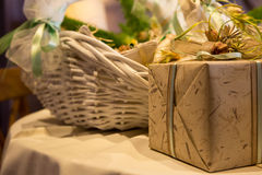 Wedding gift table. With yellow tablecloth, gift and basket Stock Images