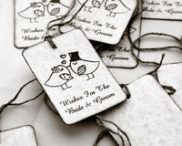 Wedding gift tags. Handcrafted bridal paper gift tags with kissing bride and groom birds Stock Photography