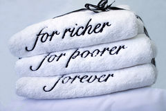 Wedding gift towels. White towels with the for richer for poorer forever message Royalty Free Stock Photography