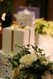Wedding gifts. Arrangement of wedding gifts with flowers and lights stock image
