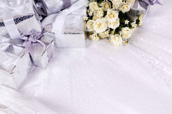 Wedding background gifts bouquet white copy space. Wedding gifts background with white rose bouquet laid on bridal lace. Space for copy royalty free stock photo