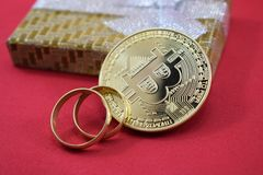 Wedding gifts, wedding rings and bitcoin. Cach Stock Photos