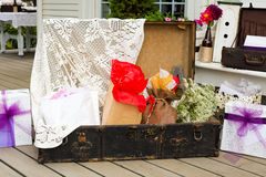 Wedding Gifts Suitcase. Wedding ceremony gifts are placed in this suitcase outdoors at a summer wedding with the theme rustic country chic Stock Photography