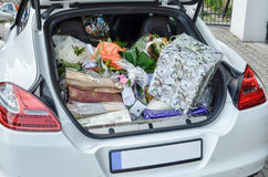 Wedding gifts in the trunk of a car. A lot of Wedding gifts in the trunk of a car Stock Image