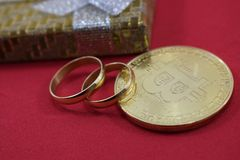 Wedding gifts, wedding rings and bitcoin. Cach Royalty Free Stock Photos