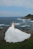 Wedding girl at cliff. Asian Wedding girl at cliff rocky island Stock Photography