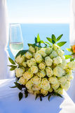 Wedding glass and bouquet Royalty Free Stock Image