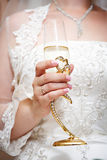 Wedding glass of champagne in hand bride Royalty Free Stock Photo
