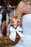 Wedding glass of champagne in hand bride Royalty Free Stock Image