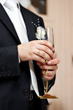 Wedding glass of champagne in hand groom Stock Photos