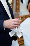 Wedding glass of champagne in hand groom Stock Photo