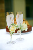 Wedding glasses. On the table in the background of a wedding cake Royalty Free Stock Images