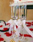 Wedding glasses. This image can symbolize love and commitment through the ritual of marriage Stock Photography