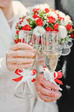 Wedding glasses. Bride and groom holding beautifully decorated wedding glasses with champaign Royalty Free Stock Photography
