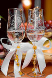 Wedding glasses. Two beautifully decorated wedding glasses with champaign Royalty Free Stock Photography