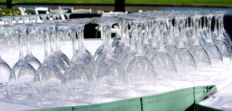 Wedding Glasses. Upside down glasses before an outdoor wedding reception royalty free stock image