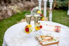 Wedding glasses with champagne. Background wedding arch Royalty Free Stock Images