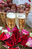 Wedding glasses of champagne on background basket with grapes Royalty Free Stock Images