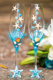 Wedding glasses for champagne and bridal bouquet Stock Photography
