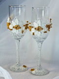 Wedding glasses of champagne. For the bride and groom on a white background Stock Image