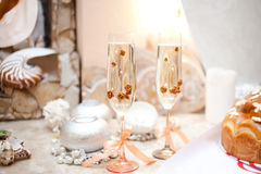 Wedding glasses of champagne on table. Close up of detail with champagne glasses Stock Photo