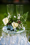 Wedding glasses. With flowers are on the other glasses Royalty Free Stock Photo