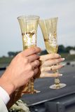 Wedding glasses. The groom and the bride hold glasses with champagne stock image