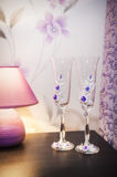 Wedding glasses and lamp Stock Photos