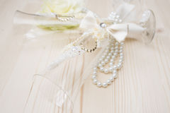 Wedding glasses with pearls stock photography