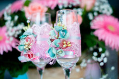 Wedding glasses. With pink ornaments Royalty Free Stock Images