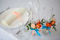 Wedding glasses and plate on the table with decorations Royalty Free Stock Photos