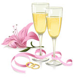 Wedding glasses with rings, ribbon and lily Stock Photography