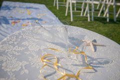 Wedding glasses and rings on the shells and starfish. Table with lace cover. Royalty Free Stock Photography