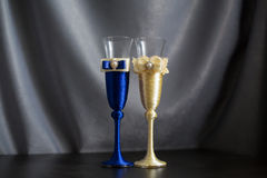 Wedding glasses on a table. Wedding glasses of blue and beige color on a table Royalty Free Stock Image