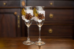 Wedding glasses on the table. Original wedding glasses on a wooden table in the interior Stock Image